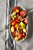 A colourful tomato salad with fresh basil