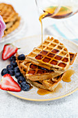 Healthy breakfast waffles with maple syrup