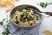 Tagliatelle in a cashew nut cream with grilled green asparagus and smoked tofu