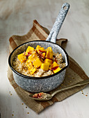 Porridge with date syrup and mango