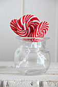 Red and white swirl lollies in a glass jar