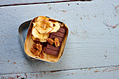 Pecan nuts, chocolate and dried apple slices