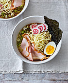 Ramen with narutomaki, roast pork, egg and spring onions