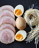 Typical ramen ingredients – chashu, pickled eggs and noodles