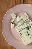 A piece of gorgonzola on a plate