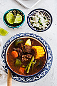 Mole De Olla (Mexican soup made from prickly pears, beef chambarete and aguja pork shoulder)