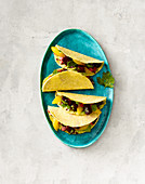 Vegan tacos with beetroot, oranges and guacamole