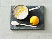 Vegan coconut rice pudding with orange zest in a saucepan