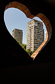 A view through a heart-shaped peephole of a tower block, Soviet district, Tbilisi, Georgia