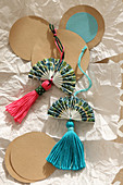 Homemade fans with tassels as decorations