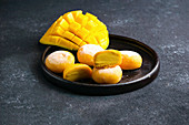 Mochi ice cream with mango (traditional Japanese rice sweets)