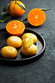 Mochi ice cream with tangerine (traditional Japanese rice sweets)