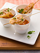 Tomato soup with fish skewers