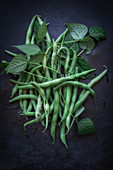 Green runner beans with leaves