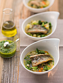 German Pichelsteiner stew with trout and lovage pesto