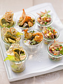Various party salads in glasses