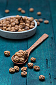 Tigernuts in a bowl and on a wooden spoon