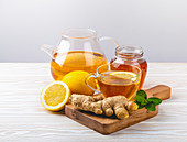 Ginger and lemon tea with fresh mint - homemade natural remedy against flu, cold and cough