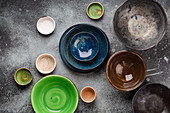 Assorted ceramic hand-made multicolored empty plates and bowls