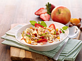 Muesli with apples, strawberries and hazelnuts