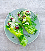 Lettuce wraps filled with feta cheese, dill and grapes