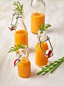 Carrot juice in flip-top jars