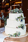 A three-tier wedding cake decorated with flowers