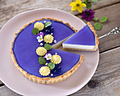 Vegan blue tea and coconut tart with a shortcrust base