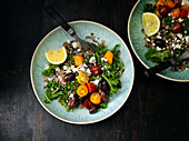 Grain salad with tomatoes, olives and feta