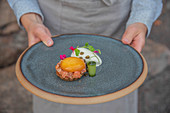 Salmon tartare with egg yolk preserved in soy sauce
