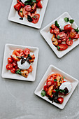 Grilled peaches with tomatoes and burrata