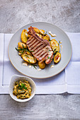 Veal cutlet with spice butter and potatoes