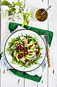 Arugula salad with pears and avocado
