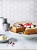 Pistachio Almond Cake with Pomegranate Sauce