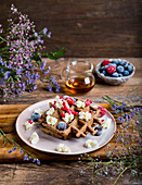 Cocoa waffles with mascarpone fruits and maple syrup