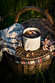 Cup of tea and picnic basket