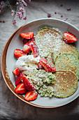 Pancakes with avocado, yoghurt and strawberries