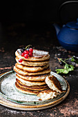 Vegan and glutenfree pancakes with black and red currant