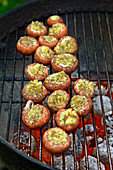 Mushrooms with potato and pesto filling on a grill rack
