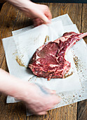 Beef rib eye steak on paper