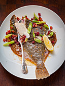 Plaice with bacon and spring onions