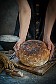 Woman hold sourdouh bread