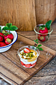 Yogurt with strawberries pistachios and maple syroup