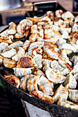 Dim sum in a pan at a market stall