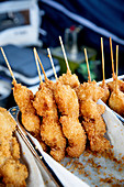 Breaded fried prawn skewers