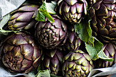 Artichokes in newspaper