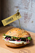 Sandwich with gorgonzola, grilled vegetables, caramelized onions and peppermint