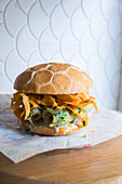 A sandwich with roast pumpkin, swordfish rolls, pumpkin chips and gorgonzola sauce