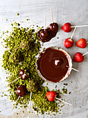 Chocolate-covered strawberries with chopped pistachios
