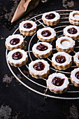 Linzer cookies with currant jelly on a cooling rack
